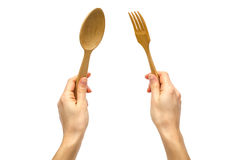 Hand of young girl holding spoon and fork. Royalty Free Stock Images