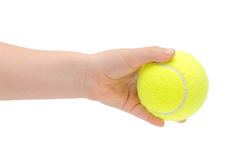 Hand of young girl holding tennis ball. Stock Photos