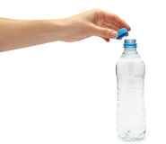 Hand of young girl holding water bottle Royalty Free Stock Photography