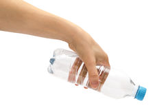 Hand of young girl holding water bottle Royalty Free Stock Photos