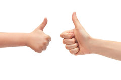 Hand of young girl and kids hand gesture, shows thumbs up. Isolated on white background Royalty Free Stock Image
