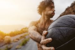 Sportsman exercising outdoors on a rainy day. Royalty Free Stock Photo