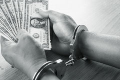 Hand young man in handcuffed hold money Stock Photos