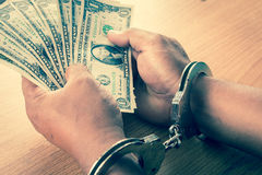 Hand young man in handcuffed hold money Stock Image