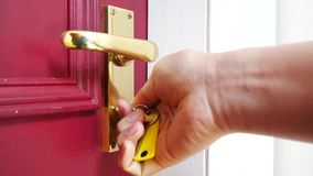 Hand of young man locks a door with a key. Conceptual footage stock video