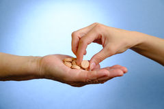 Hand of young woman and elderly woman holding the pills Stock Photos