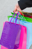 Hand of young woman with gift bags Stock Image