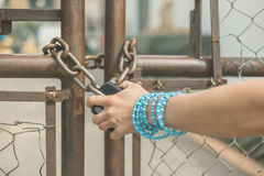 Hand of young woman grabbing padlock Stock Image