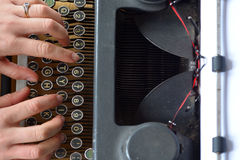 Hand of a young woman writer writing on antique typewriter Stock Image