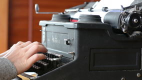 Hand of a young woman writer writing on antique typewriter stock video footage
