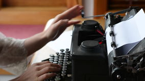 Hand of a young woman writer writing on antique typewriter. Type Writing Concept stock video footage