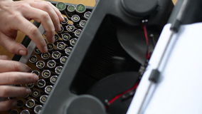 Hand of a young woman writer writing on antique typewriter stock video