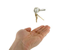 Handandkeys2. Keys tossed into the air royalty free stock image