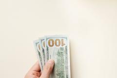 Handangebot drei hundert Dollar Stockfotografie