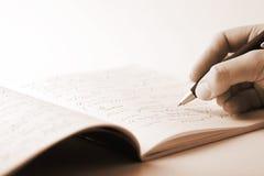 handanteckningsbokwriting royaltyfria bilder