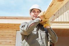 Handarbeider met hout Stock Foto