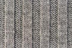 handarbete Lodlinjen gjorde randig textur för grå färgrät maskatyg, stucken modellbakgrund arkivbilder