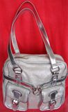 Handbag. Of silver color with metallic finding on red background Stock Photo