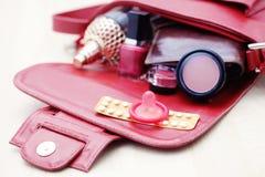Handbag. Birth control pill with condom - healthcare and medicine Royalty Free Stock Photography