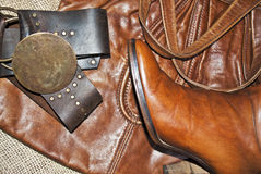 Handbag,boots and belt. An handbag with a pair of boots and a belt,all made of leather stock images