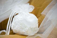 Handbag of the bride. On a brown background royalty free stock images