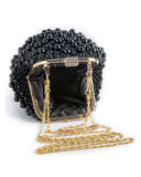 Handbag on a chain decorated with black beads. Stock Photo