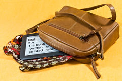 Handbag and ebook Stock Image