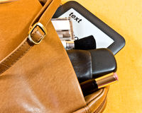 Handbag, ebook and phone Royalty Free Stock Photography