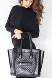 Handbag. Elegant woman with handbag studio shot royalty free stock photos