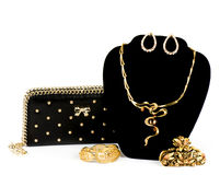 Handbag and golden jewelry Stock Photography