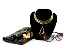 Handbag and golden jewelry Royalty Free Stock Image