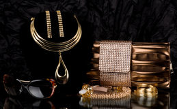 Handbag and golden jewelry, glasses Stock Images
