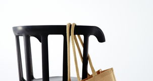 Handbag hanging on a chair stock video