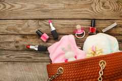 handbag with items to care for child stock images