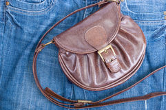 Handbag and jeans Stock Photos