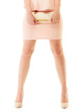 Handbag and legs of girl in pink dress and high heels. Female elegance. Shiny handbag and sexy legs of girl in light pink dress or skirt and high heels isolated Stock Photography