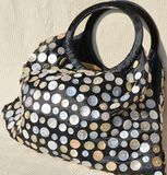 Handbag with mother of pearl buttons royalty free stock photography