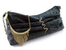 Handbag and necklace Stock Photos