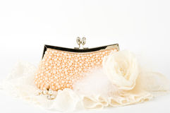 Handbag and pearl jewelry Stock Images