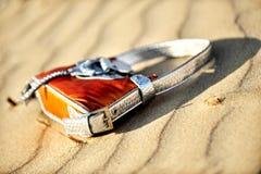 Handbag on the sand Royalty Free Stock Photo