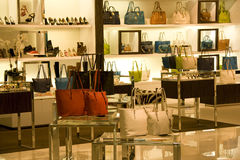 Handbag and shoe store. A store selling expensive handbags and shoes and other woman clothing accessories Stock Image