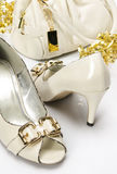 Handbag and Shoes. A pair of cream color high heels and a handbag royalty free stock photography