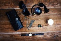 Handbag with sunglasses and earring. Women's accessories. Handbag with sunglasses and earring Royalty Free Stock Photo