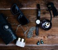 Handbag with sunglasses and earring. Women's accessories. Handbag with sunglasses and earring Stock Image