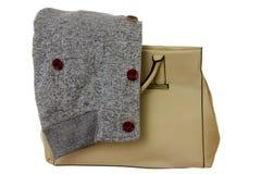 Handbag with sweatshirt. Beige handbag and gray sweatshirt before autumn walk Stock Images