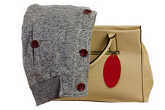 Handbag with ticket. Beige handbag with ticket  and gray sweatshirt in autumn Royalty Free Stock Image