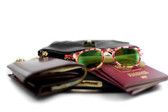 Handbag for travel with a purse, sunglasses, passports Royalty Free Stock Photography