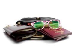 Handbag for travel with a purse, sunglasses, passports Stock Photo