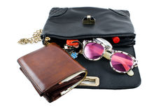 Handbag for travel with a purse, sunglasses, passports Royalty Free Stock Images