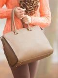 Handbag in woman hands. Fall autumn fashion. Stock Image